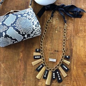 Loft Necklace, tiny bag, and necklace.